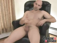Firm bodied bald gay Bucky wanking his enormous cock hard