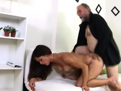 Alyona sits on the lap of her older man looking very sexy