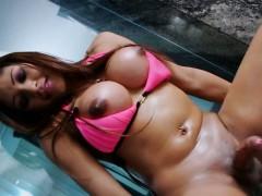 Booby TS Patricia Texeira handjobs cock until she cums